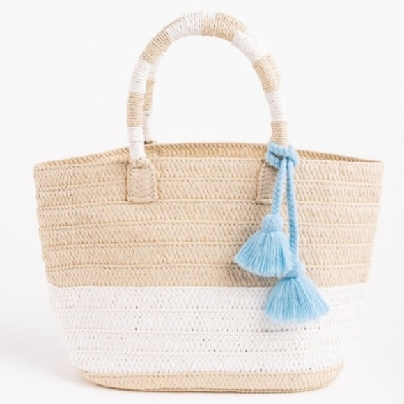 ALTRU straw tote with blue tassel